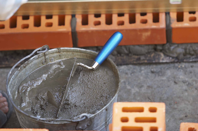 как обложить металлическую печь кирпичом