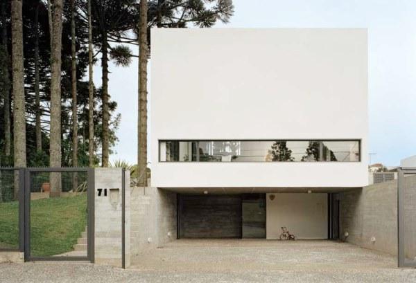 дом белого цвета Una Arquitetos