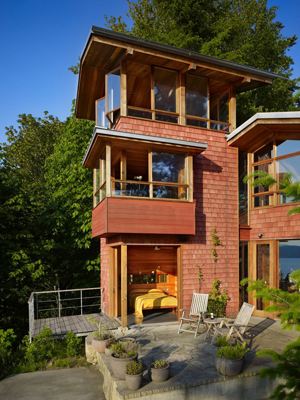 фото дома на озере по проекту BjarkoSerra Architects