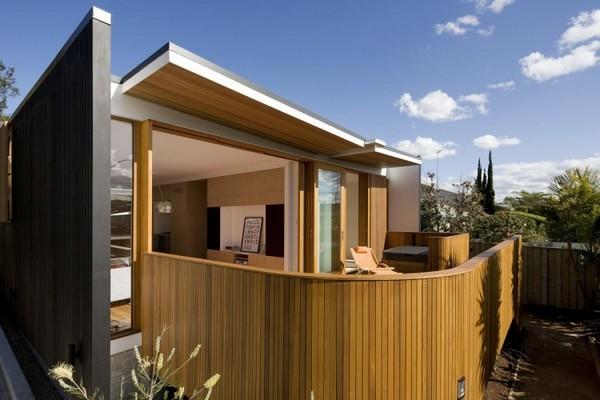 Дом облицованный деревом фото 1