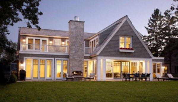 Загородный дом с галечной кладкой фасада фото 1
