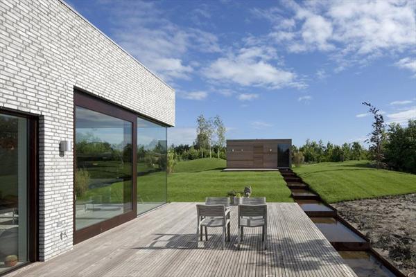 кирпичный дом со стеклянным фасадом фото 4