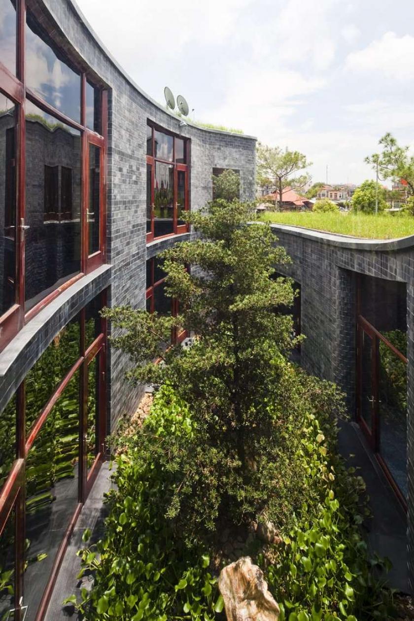 фото каменных домов - проект Torus House
