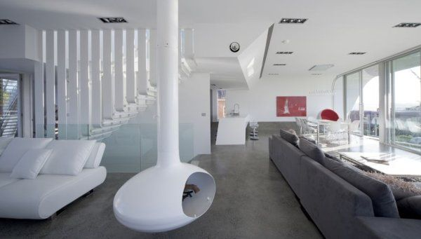 гостиная в доме «Лента Мебиуса» по проекту Tony Owen Partners
